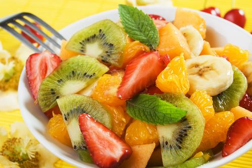 Fresh fruit salad with kiwi, melon, orange and strawberry