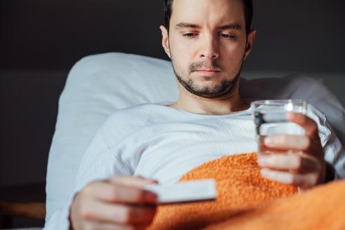 Sick man using drugs. Flu. Man caught cold. Headache. Virus